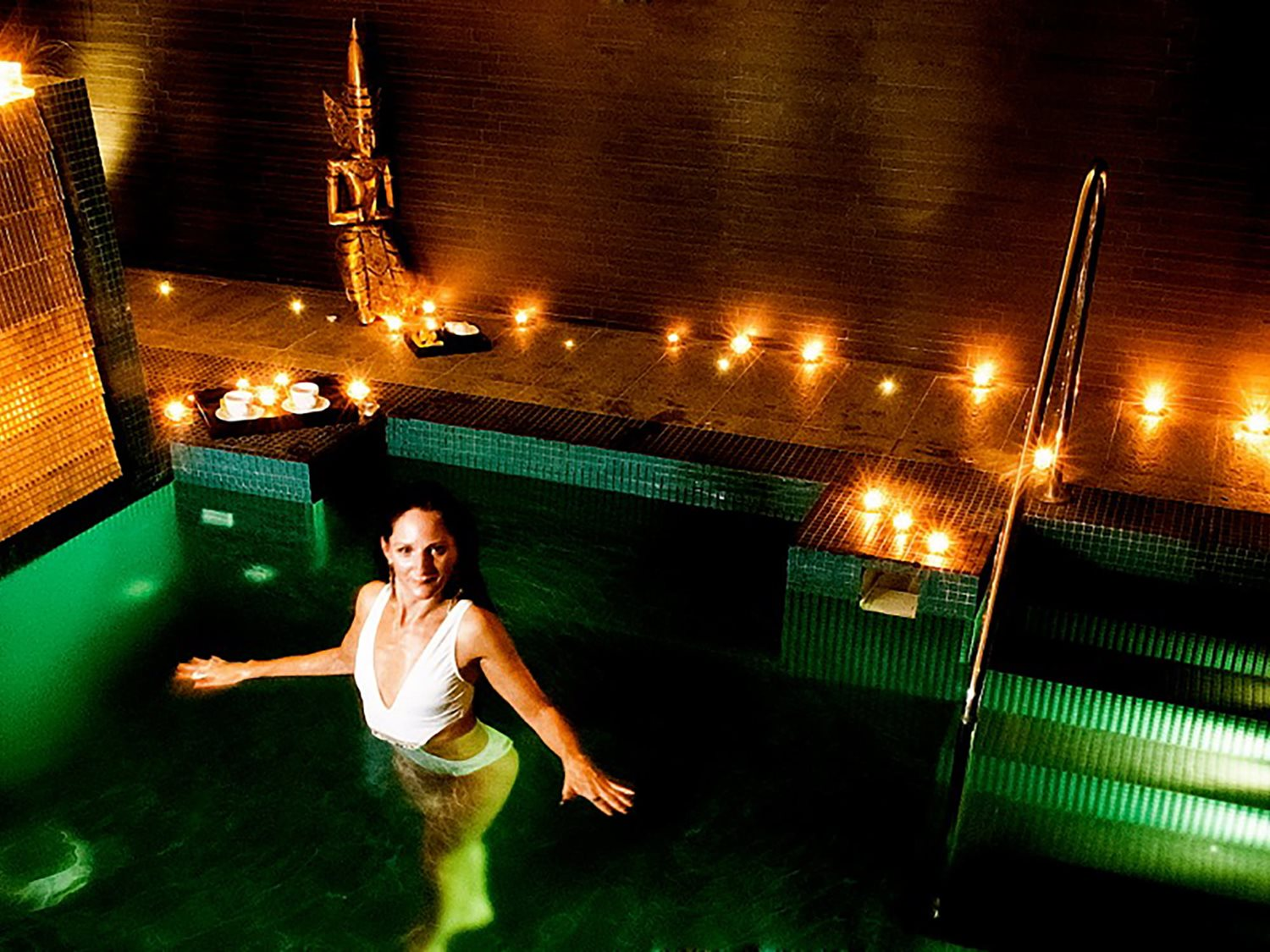 Relax in your own candlelit private pool